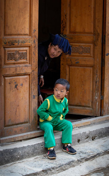 Childhood Child Real People Innocence Portrait Architecture Casual Clothing Leisure Activity Rural Scene Boys Two People Grandma Curious Yunnan Ethnic Door Steps And Staircases