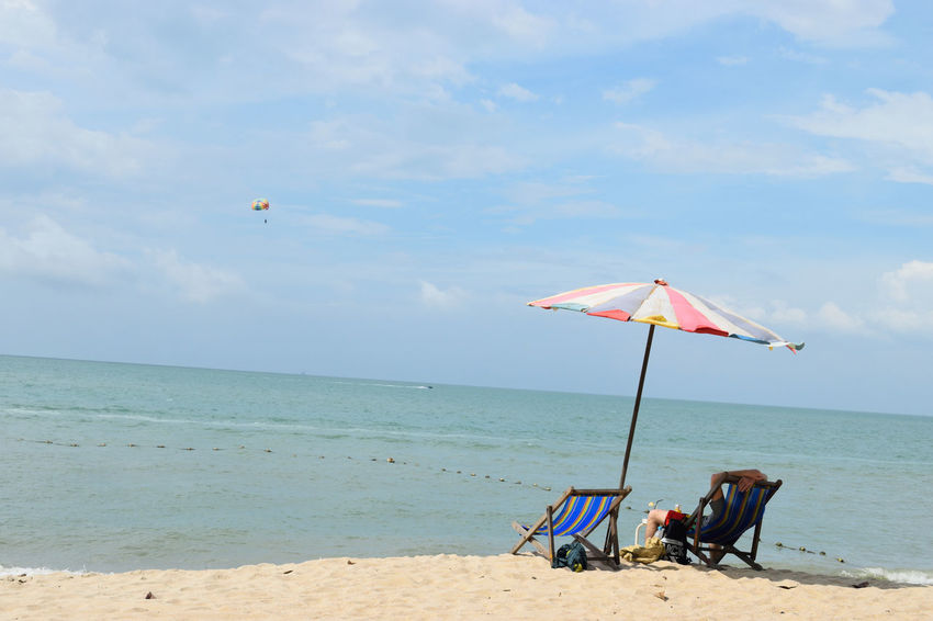 Beach Sand Sea Water Flying Kite - Toy Outdoors Horizon Over Water Day Nature Cloud - Sky Sky People One Person Parachute Lifeguard Hut The Purist (no Edit, No Filter) A Day In The Life Malaysia Moments Backpacking Facing Away Relaxation Lifestyles Paragliding