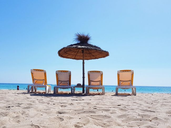 Beach Sand Sea Vacations Summer Blue Sky Day Nature Outdoors Horizon Over Water Travel Destinations Beach Day Beach Umbrella Beach Holiday Clear Sky Water No People Djerba, Tunisia Djerba  Deckchair Deck Chairs
