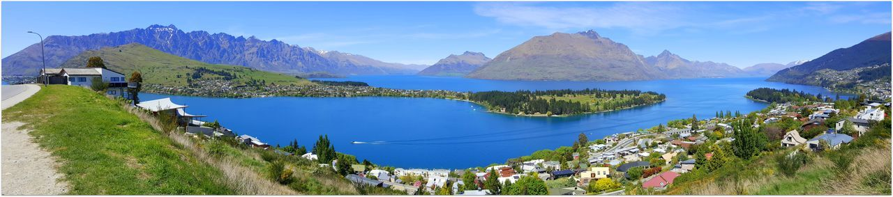 Panoramic Shot Of Calm Lake Against Mountain Range