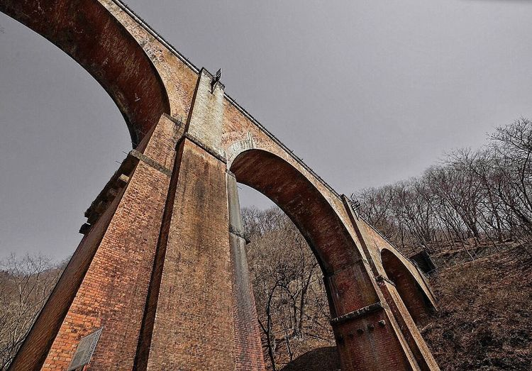 Low Angle View Of Viaduct Railway Bridge Against Sky