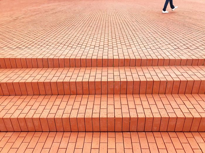 Woman walking over red brick floor Bricks Brick Red Walking Walk Pattern Outdoors Day Real People One Person People