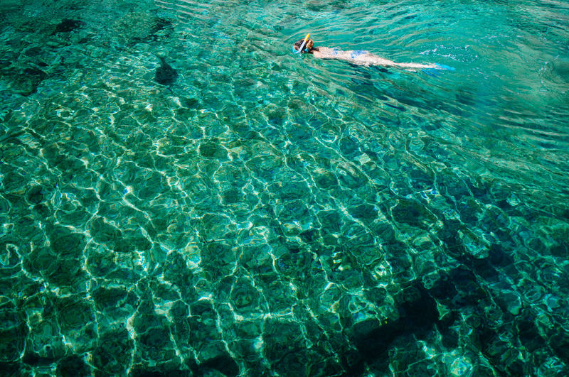 High angle view of person swimming in sea