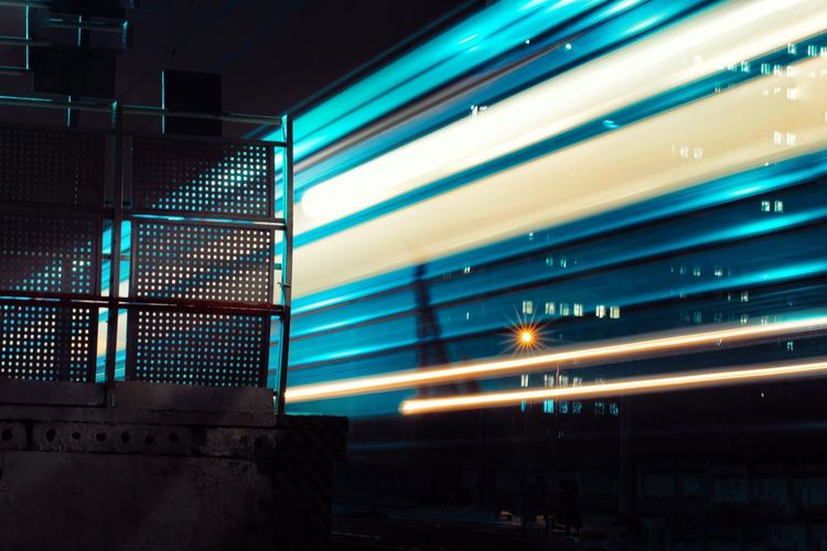 Illuminated Architecture Built Structure Night Lighting Equipment No People Building Exterior Transportation Text Mode Of Transportation Western Script Outdoors City Light - Natural Phenomenon Sign Train - Vehicle Long Exposure Rail Transportation Communication Ceiling