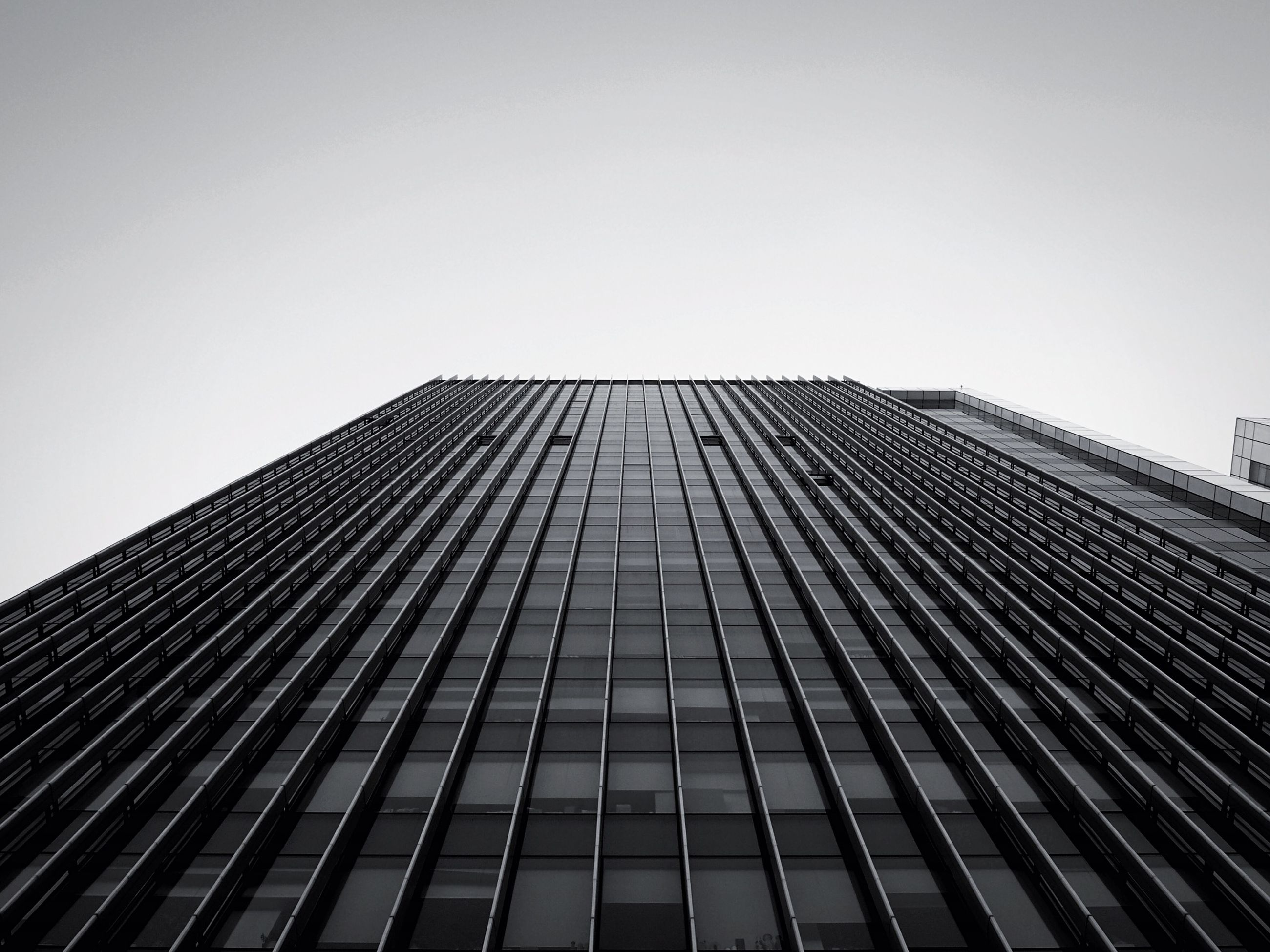 architecture, building exterior, built structure, low angle view, modern, skyscraper, office building, tall - high, city, clear sky, tower, building, tall, sky, day, glass - material, copy space, outdoors, no people, pattern