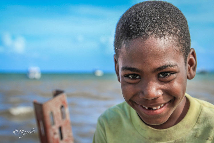 chimuelo Beach Cheerful Childhood Close-up Day Focus On Foreground Happiness Headshot Looking At Camera Nature One Person Outdoors People Portrait Real People Sea Sky Smiling Water