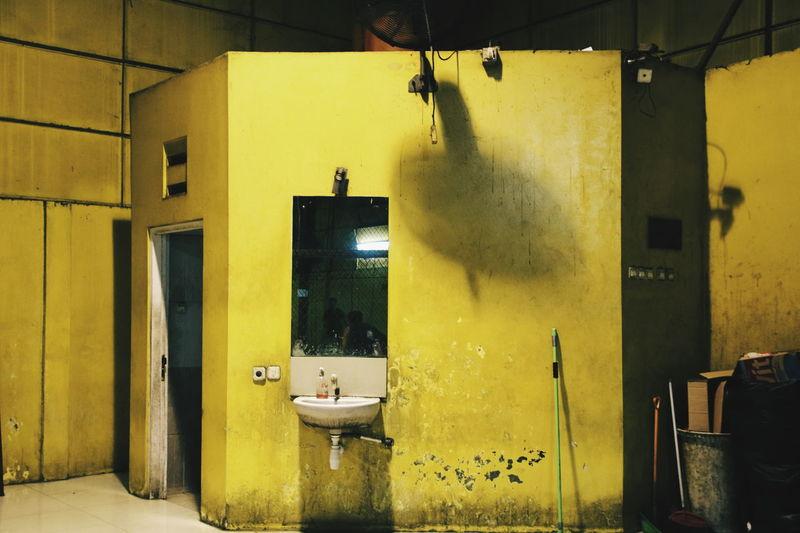 Yellow wall in bathroom