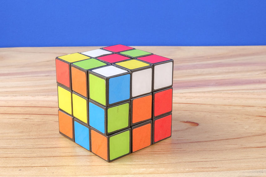 RUBIK'S CUBE , CREATIVITY TOY Creativity Rubik Cube Balance Block Block Shape Close-up Cube Shape Design Focus On Foreground Geometric Shape Group Of Objects Indoors  Intelligence Multi Colored No People Puzzle  Rubik Shape Stack Still Life Table Toy Toy Block Wood - Material