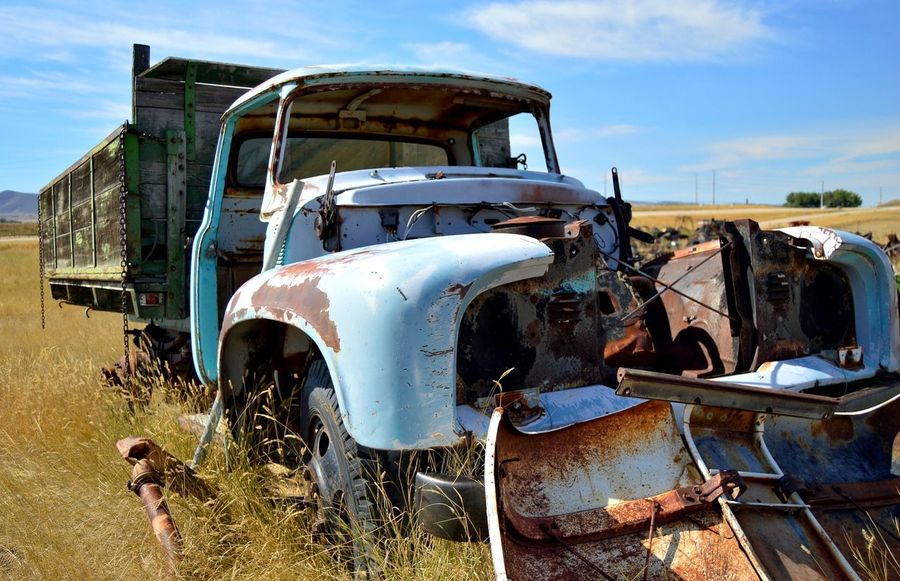Stripped Outdoors Clouds And Sky Blue Color Rusted Deteriorated Sunshine Shadow North Of Douglas Wyoming Land Vehicle Abandoned Damaged Junkyard Bumper Truck