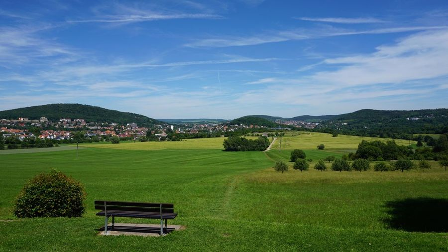 From The Top Of The Hill Scenic View Field Bench Countryside Cityscape Plant Sky Grass Cloud - Sky Beauty In Nature Nature Scenics - Nature Green Color Tranquility Growth Landscape Seat Environment No People Tranquil Scene Field Day Bench Tree