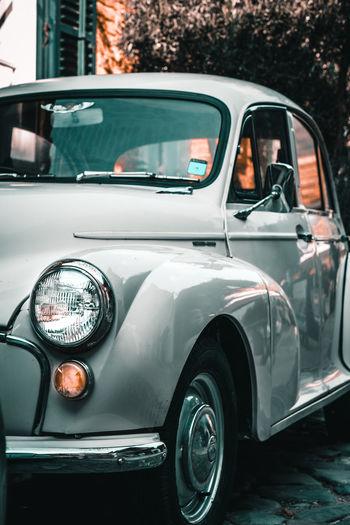 Vintage car parked in city