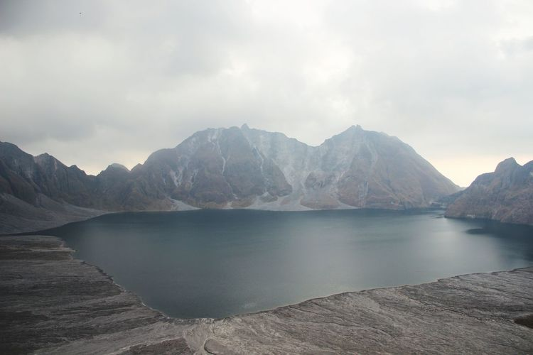 Inside Mt. Pinatubo's crater. The second-largest volcanic eruption of the 20th century. A BEAUTIFUL DISASTER Landscape Mountain Nature Lake Scenics Water Beauty In Nature Outdoors Reflection Travel Photooftheday Philippines Travel Destinations Hiking