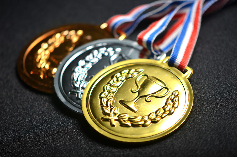 Medals close up over black background Achievement Bronze Bronze Statue Competition Gold Medal Motivation No People Silhouette Sport Sunset Win