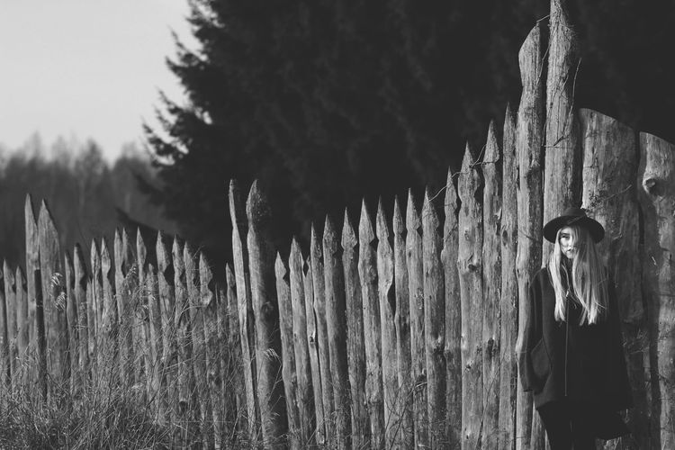 American Architecture Art Blackandwhite Casual Clothing EyeEm Nature Lover Fence Field Freedom Girl Hat Lifestyles Meadow Nature_collection Outside Portrait Portrait Of A Woman Romantic Sky Standing Tree Wall - Building Feature Wood Wood - Material Young
