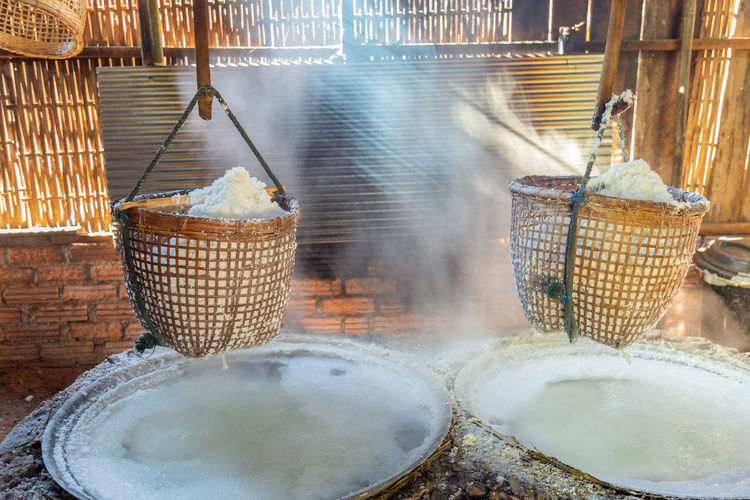 Rock salt process with ancient method for boiling brine into salt with smoke and light.