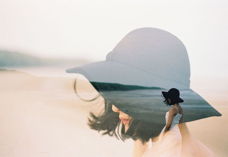 Double exposure of woman at beach