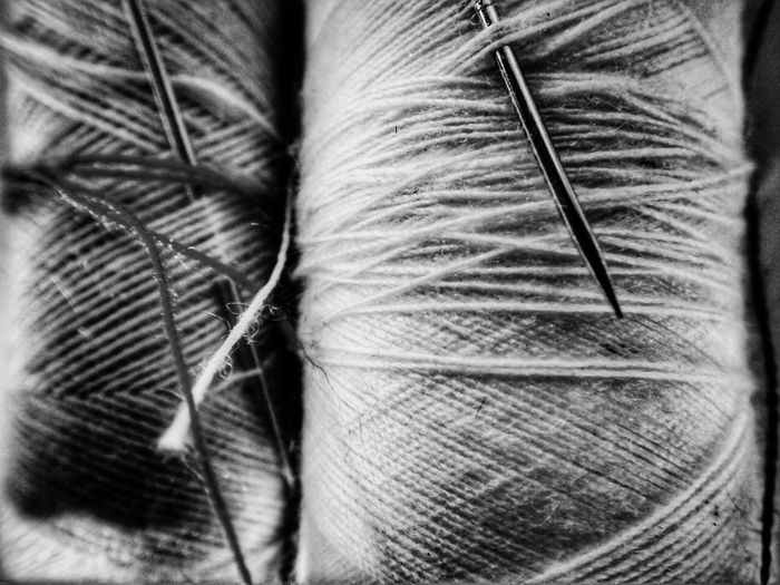 Thread and needles. EyeEm Selects Mobilephotography Blackandwhite Home Fineart Fine Art Photography Contrast Full Frame Backgrounds Close-up Needle Needlecraft Product Fabric Textile Thread Cloth Sewing Needle Loom Sewing Item Textured