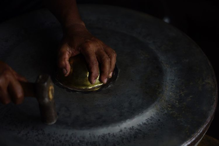 Close-up of man with gong