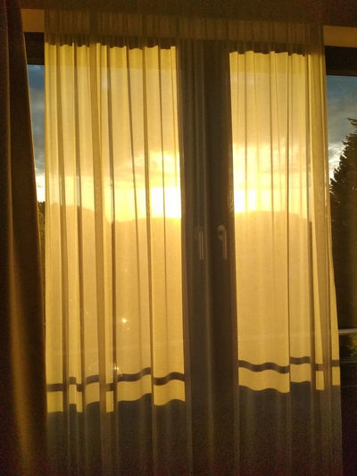 Close-up of curtain against window at home