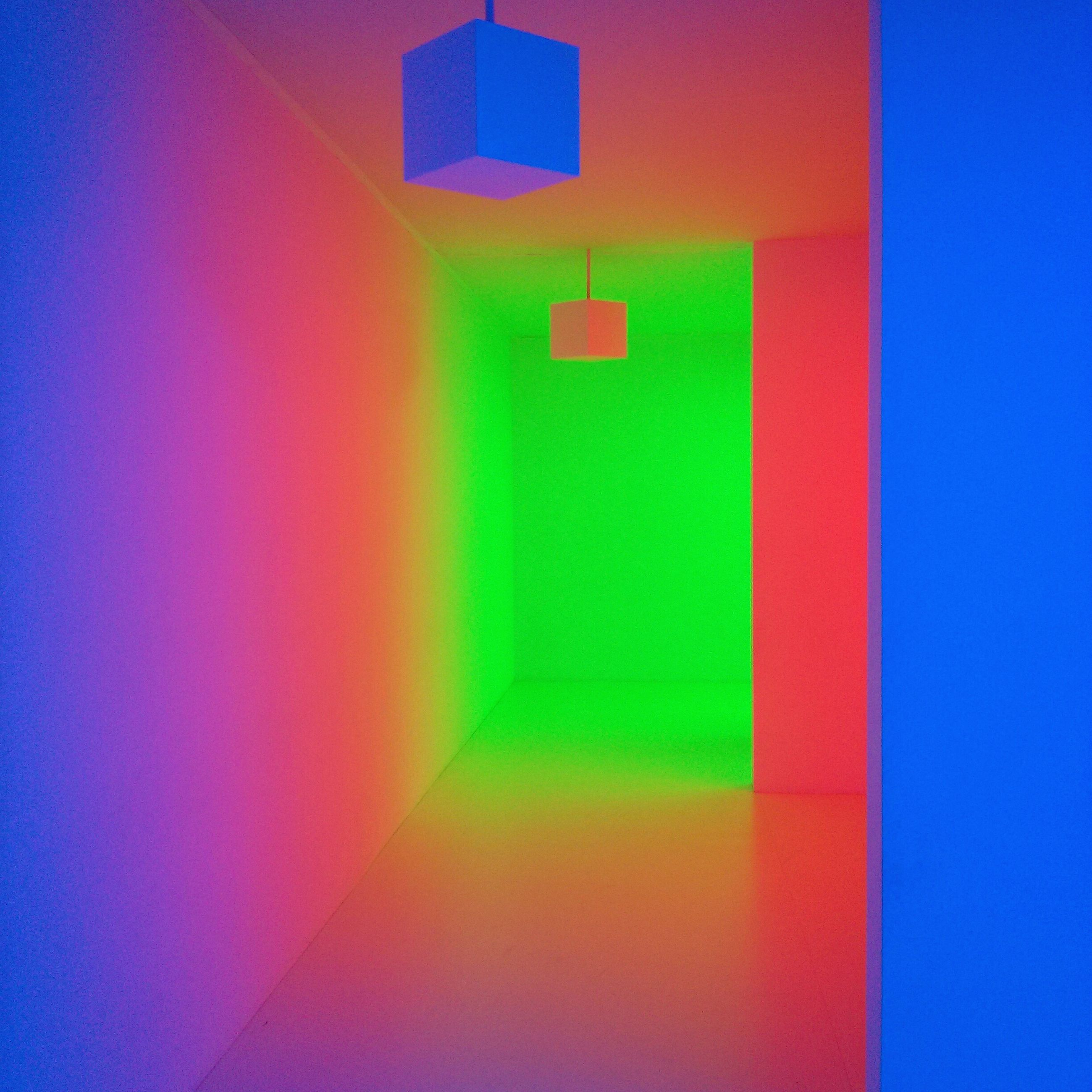 blue, indoors, wall - building feature, multi colored, illuminated, wall, red, built structure, architecture, communication, no people, colorful, lighting equipment, green color, copy space, guidance, yellow, pattern, close-up, geometric shape