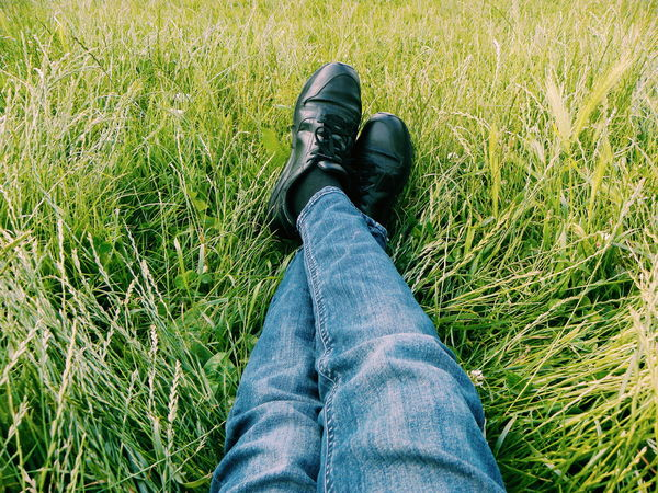 Low Section Human Leg One Person Jeans Grass Personal Perspective Outdoors Nature Lifestyles Green Colour Laying On The Grass  Resting Time With Nature Sitting Wearing Jeans Time Out Time With Myself Contrasting Colors Blue Jeans Meditation Tranquility Relaxing By My Own Looking Down Looking At Me