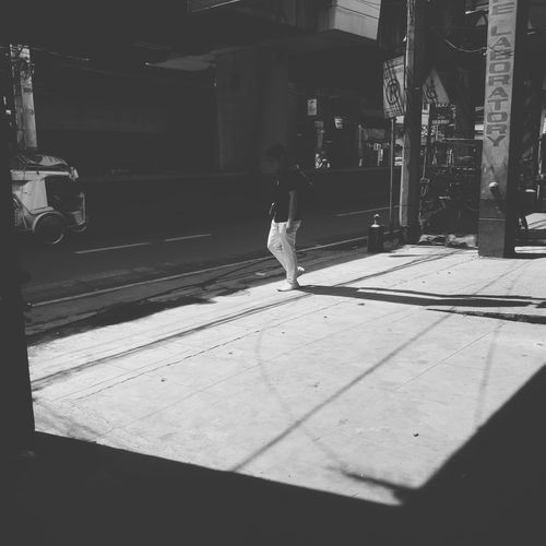 White pants Manila Full Length Shadow Childhood Child Sunlight Street Scene Sidewalk Walking City Street Pedestrian Street
