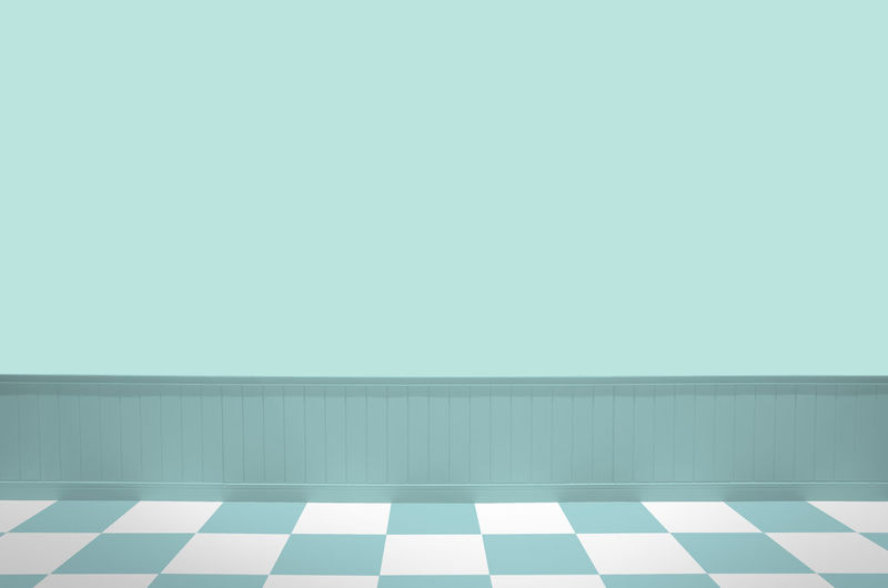 View of white wall with tiled floor