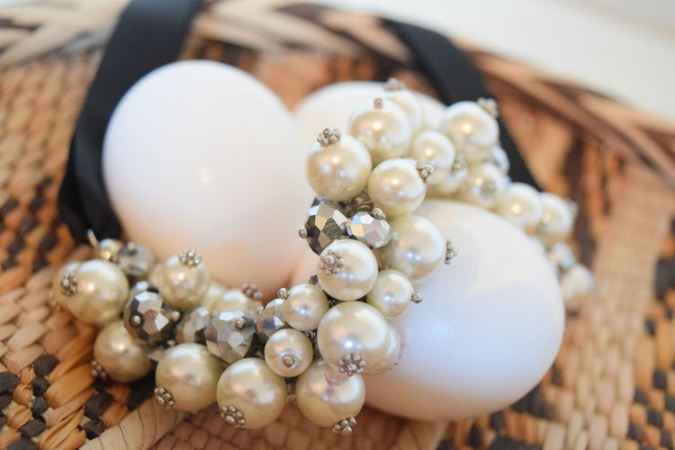 Close-Up Of Animal Eggs With Pearl Jewelry