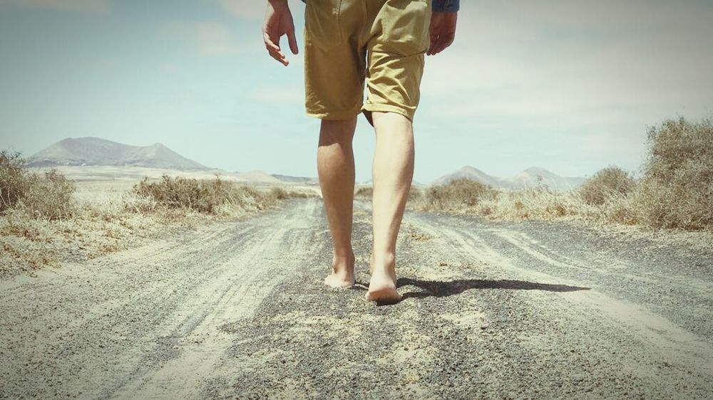 Only Men Road Walking Away Human Leg Going For A Walk Vacations Adventure Desert Sky Human Body Part Walking Arid Climate Nature Sand Bare Foot Summer One Man Only Lifestyles Breathing Space Horizon Rural Scene Landscape