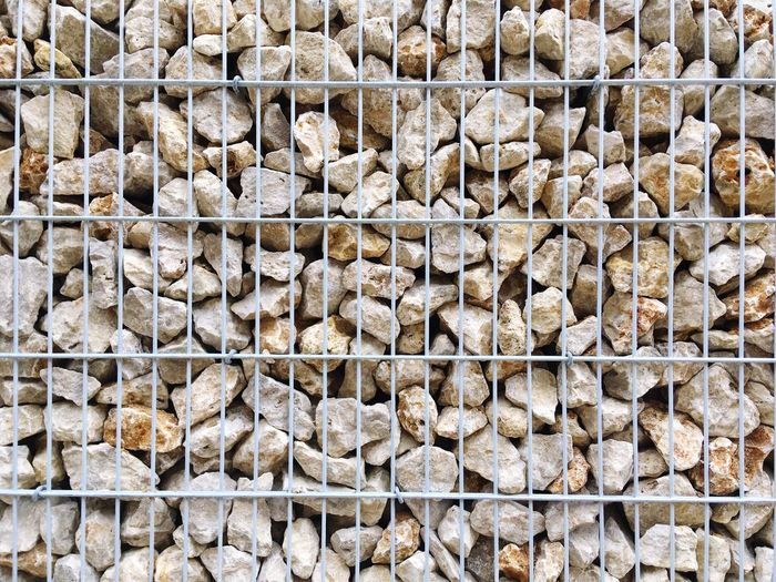 Large Group Of Objects Backgrounds Full Frame Abundance No People Textured  Outdoors Nature Day Close-up Boulder Stones Background Cage Metal Stone Wall Structure
