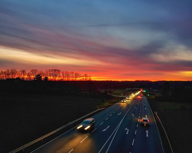 Into the sunset Colorful Nature Cars Longexposure Streetlights Burning Sky Afterglow Street Sunset Road Journey Arrival Sky Landscape Cloud - Sky Travel Moving Street Scene Road Marking