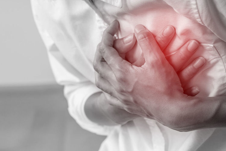 Digital composite image of man touching chest in pain