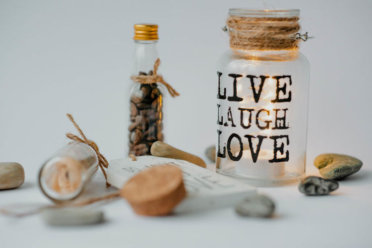 Close-up of glass jar on white background