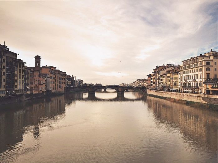 Ponte Vecchio Bridge Over Arno River Amidst Buildings
