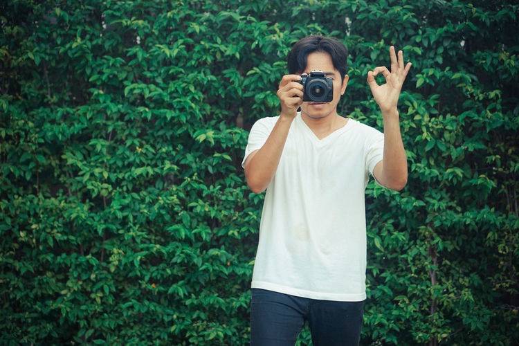 Full length of a man holding camera