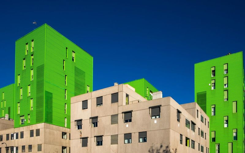 Low Angle View Of Residential Buildings Against Blue Sky