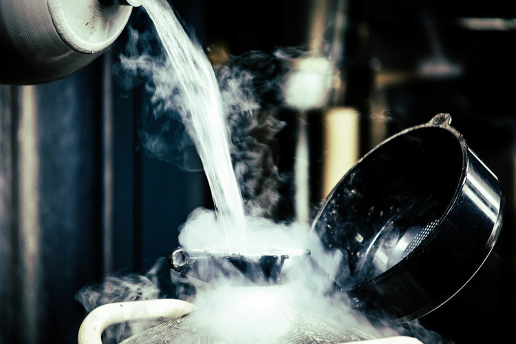 Close-up of liquid nitrogen being poured in container