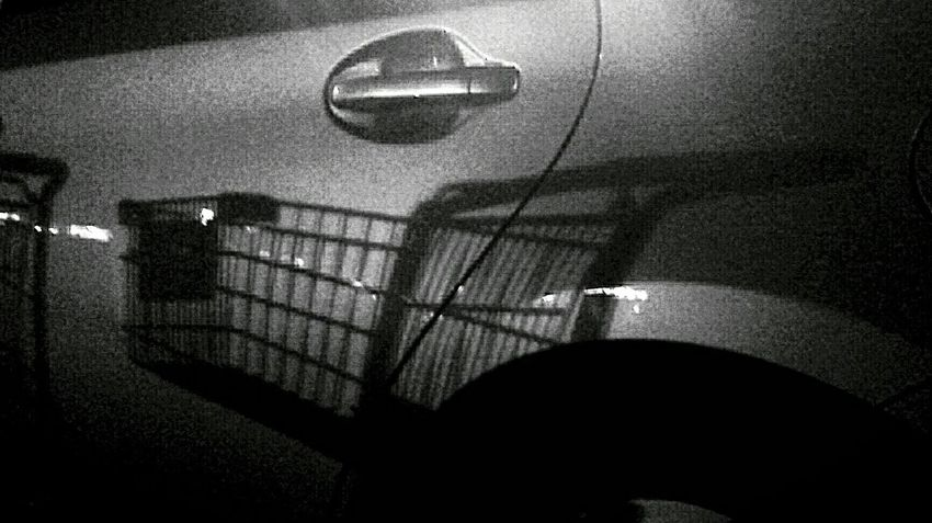 Precision Shopping cart reflected onto the side of a car Blackandwhite Eye4black&white  Monochrome Reflection Reflection_collection Urban Reflections Urban Geometry Silhouette Surrealism Taken with Samsung Galaxy S4.