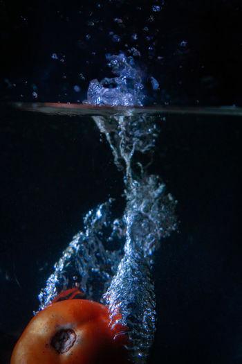 Close-up of hand splashing water