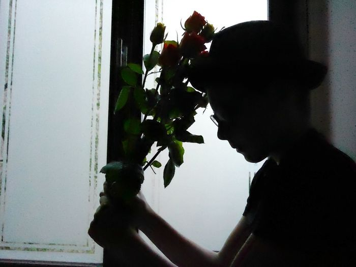 🌹 Alone Lonely Leave Abandoned First Love Boy Alone Misunderstanding Forgive Forgiven Change Boy Yes No Teenager Flower Holding Silhouette Child Real People Flower Flower Silhouette Hat Flower Bouquet  Shad Window Sad