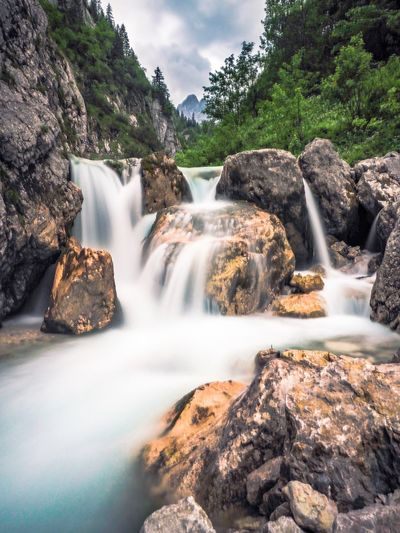 Waterfall in the German Alps Recreation  Travel Destinations Waterfall River Nature Bavarian Alps Garmisch-partenkirchen Alps Water Long Exposure Scenics - Nature Beauty In Nature Rock Waterfall Nature Rock - Object Motion No People Solid Flowing Water Blurred Motion Day Non-urban Scene Cloud - Sky Plant Tree Sky Flowing