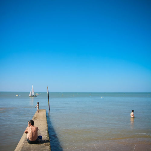 Water Sea Sky Scenics - Nature Beauty In Nature Horizon Horizon Over Water Nature Atlantic Ocean Bretagne Summer Beauty In Nature Holidays Sailboat Real People Leisure Activity Lifestyles Blue Men Clear Sky Two People Day Rear View Copy Space Shirtless Outdoors My Best Photo
