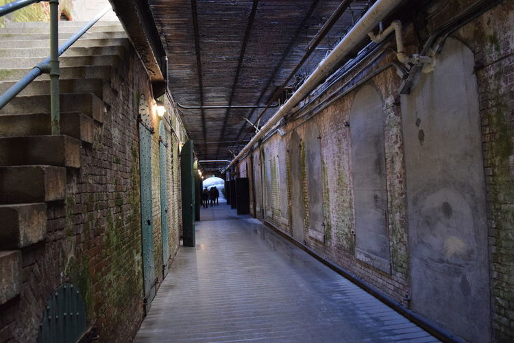 Narrow alley in tunnel