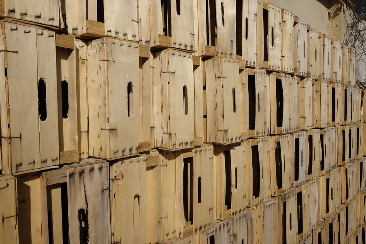 Wooden crates stacked outdoors