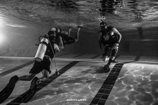 Pic of divers in the swimming pool while they were reviewing their open water skills Water Real People Swimming Pool Men Full Length Sport Lifestyles Scuba Diving Day Outdoors Competitive Sport Adult People Adults Only Khubar Alkhobar Saudi Arabia Riyadh Jeddah Dammam