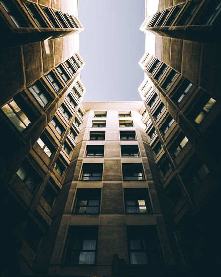 Depths of city Built Structure Architecture Building Exterior Building City No People Sky Nature Modern Low Angle View Office Window Outdoors Tall - High Office Building Exterior Strength Day Clear Sky Residential District Growth Skyscraper Apartment High Directly Below Urban Urbanphotography Symmetry Symmetryporn Symmetrical Cityscape The Architect - 2019 EyeEm Awards
