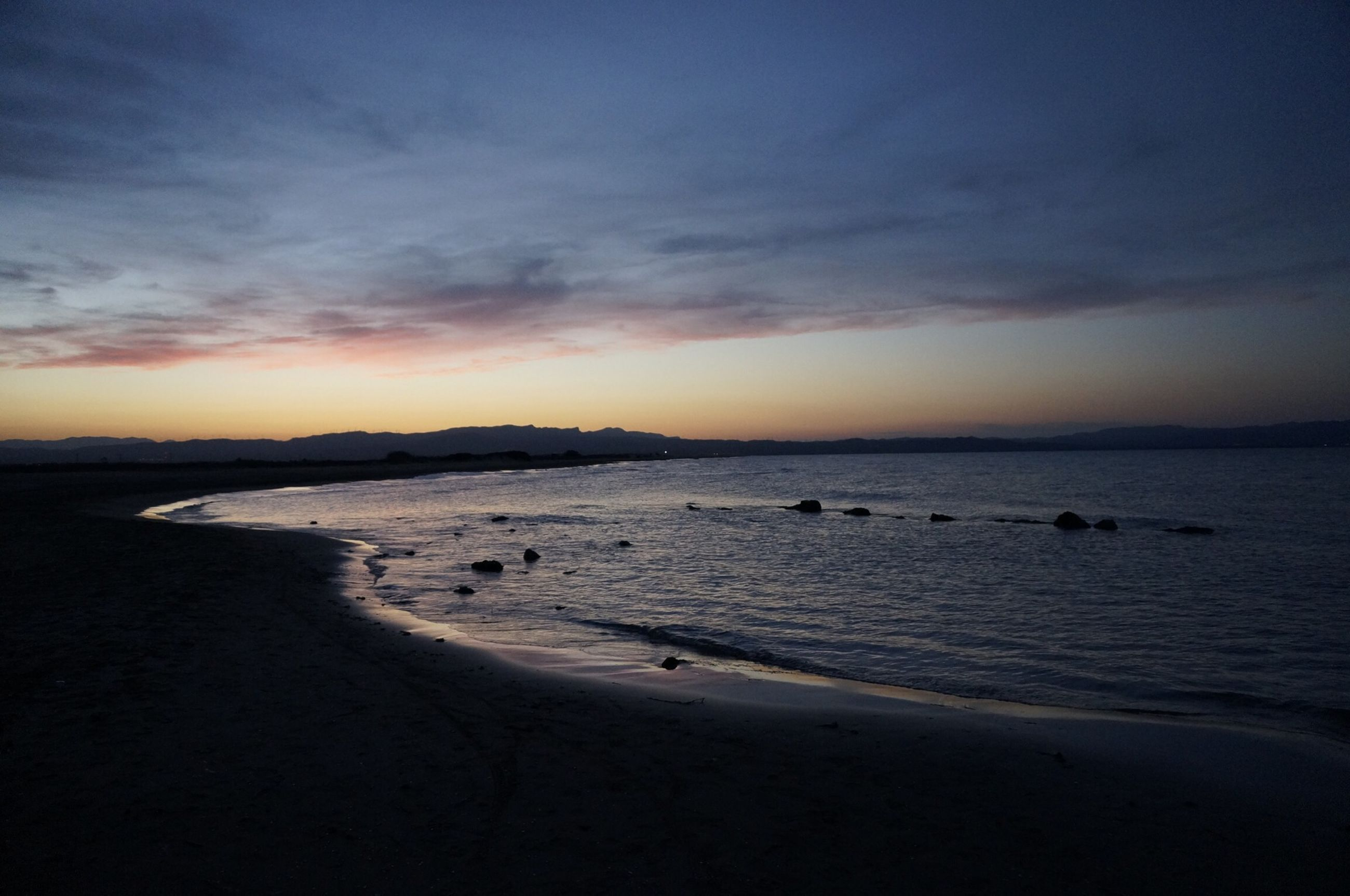 sea, beach, water, sunset, shore, tranquil scene, scenics, sky, beauty in nature, tranquility, sand, horizon over water, nature, coastline, cloud - sky, idyllic, dusk, silhouette, wave, cloud