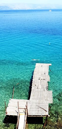 High angle view of pier on sea against sky