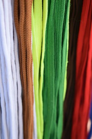 Colorful Laces Arrangement Backgrounds Brown Lace Choice Close-up Clothing Fashion Green Lace Hanging In A Row Indoors  Large Group Of Objects Multi Colored Red Lace Retail  Selective Focus Shoe Lace Textile Variation White Lace Yellow Laces