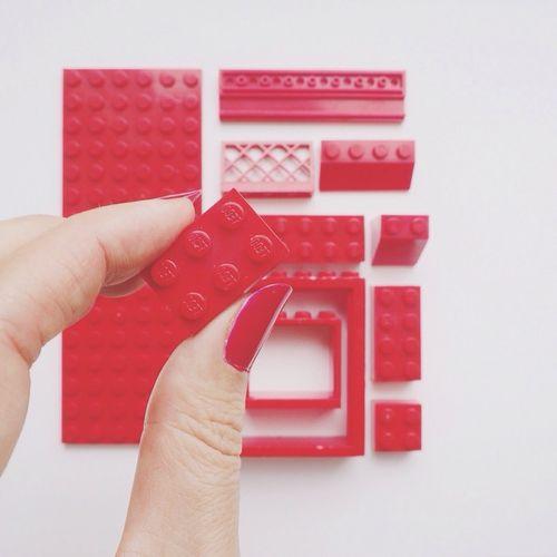 Close-up of hand building blocks